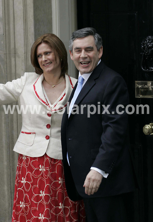 **ALL ROUND PICTURES FROM SOLARPIX.COM**.**NO UK NEWSPAPER PUBLICATION **UK MAGAZINE PUBLICATION ONLY** AND NO PUBLICATION IN FRANCE, SCANDINAVIA, AUSTRALIA AND GERMANY** .New British Prime Minister Gordon Brown and wife Sarah arrive at 10 Downing Street .JOB REF: 27.06.07        SFE       DATE: 27.06.07.**MUST CREDIT SOLARPIX.COM OR DOUBLE FEE WILL BE CHARGED* *UNDER NO CIRCUMSTANCES IS THIS IMAGE TO BE REPRODUCED FOR ANY ONLINE EDITION WITHOUT PRIOR PERMISSION*