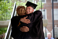 Nick Culbertson (right), of Dunhellen, New Jersey, receives his diploma from Quincy House Master Deborah Gehrke at the Quincy House ceremony during Harvard University Commencement on May 26, 2011, in Cambridge, Massachusetts, USA.<br /> <br /> Photo: M. Scott Brauer for the Star-Ledger