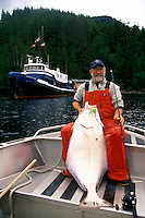 Dave Vedder with a 55 pound Halibut caught on a jig in the Queen Charlotte Islands of British Columbia, Canada at Queen Charlotte Adventures.
