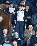 Barrie McKay coming down the steps of the directors box on crutches and his broken foot in a moon boot