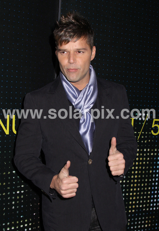 **ALL ROUND PICTURES FROM SOLARPIX.COM**.**SYNDICATION RIGHTS FOR UK, AUSTRALIA, DENMARK, PORTUGAL, S. AFRICA, SPAIN & DUBAI (U.A.E) ONLY**.Armani 5th Avenue Store Grand Opening Celebration Arrivals in New York City, USA.This pic:  Ricky Martin.JOB REF:     PHZ/Mayer    DATE:  18.02.09.**MUST CREDIT SOLARPIX.COM OR DOUBLE FEE WILL BE CHARGED**.**ONLINE USAGE FEE  GBP 50.00 PER PICTURE - NOTIFICATION OF USAGE TO PHOTO @ SOLARPIX.COM**