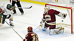 18 October 2009: Boston College Eagle goaltender John Muse, a Junior from East Falmouth, MA, gives up a third period goal to University of Vermont Catamount forward Wahsontiio Stacey, a Junior from Kahnawake, Quebec, at Gutterson Fieldhouse in Burlington, Vermont. The Catamounts defeated the visiting Eagles 4-1. Mandatory Credit: Ed Wolfstein Photo