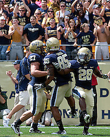 Pitt celebrates a 2-yard touchdown run by Dion Lewis. Pictured are Henry Hynoski #27, Mike Cruz #85 and Dion Lewis #28. The Pittsburgh Panthers defeat the New Hampshire Wildcats 38-16 at Heinz Field, Pittsburgh Pennsylvania on September 11, 2010.