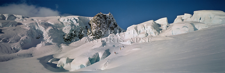 Three skiers on the Tasman Glacier. Mount Cook National Park. New Zealand.