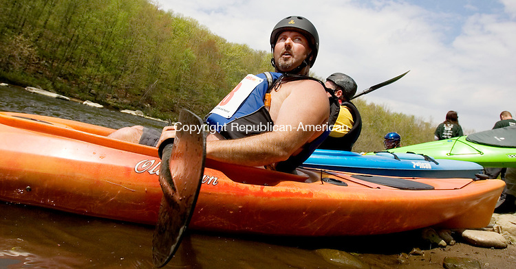 WATERBURY, CT. 05 May 2011-050711SV03--Larry Cauchon of Seymour waits for the start while heading down the Naugatuck River on Platts Mill Road in Waterbury Saturday. Kayakers and canoe racers paddled 6 miles from Waterbury to Beacon Falls during the 4th Annual Naugatuck Valley River Race and Festival. The event was sponsored Connecticut Outdoors, LLC and Beacon Falls Merchant Association.<br /> Steven Valenti Republican-American