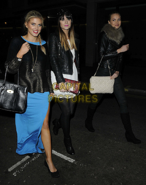 Ashley James, Lilah Parsons & Ianthe Rose Cochrane Stack.The Beautiful Movements Cosmetics relaunch party, Sanctum Soho Hotel,  London, England..March 12th, 2013.full length blue white dress leather jacket tights slit split bag purse black top red clutch black.CAP/CAN.©Can Nguyen/Capital Pictures.