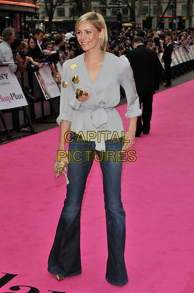 "JENNI FALCONER .""The Back-Up Plan"" UK Gala Film Premiere, Vue cinema Leicester Square, London, England, UK, 28th April 2010..arrivals full length grey gray blouse top flared flares jeans bell bottoms wrap gold clutch bag .CAP/PL.©Phil Loftus/Capital Pictures."