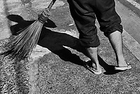 Street Photography, Manila, Philippines Sweeping the footpath