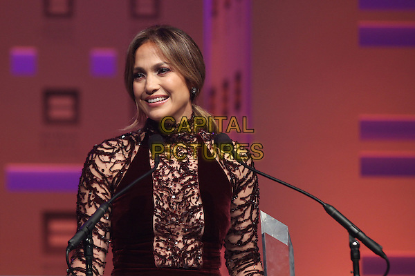 Jennifer Lopez <br /> at the 2013 HRC National Dinner at the Washington Convention Center on October 5, 2013 in Washington, DC, USA, <br /> October 5th 2013.<br /> half length red velvet dress beaded high neck smiling  maroon burgundy sheer pattered speaking microphone <br /> CAP/MPI/mpi34<br /> &copy;mpi34/MediaPunch/Capital Pictures