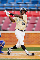Kevin Jordan #21 of the Wake Forest Demon Deacons follows through on his swing against the UNC-Asheville Bulldogs at Wake Forest Baseball Park on February 28, 2012 in Winston-Salem, North Carolina.  The Demon Deacons defeated the Bulldogs 9-8.  (Brian Westerholt/Four Seam Images)