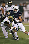 Nevada's Richy Turner (2) collides with Colorado State's  Kevin Pierre-Louis (26) during the second half of an NCAA college football game in Reno, Nev., on Saturday, Oct. 11, 2014. Colorado State defeated Nevada 31-24. (AP Photo/Cathleen Allison)