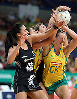 02.11.2008 Silver Ferns Irene Van Dyk Maria Tutaia (L)  and Australia's Mo'onia Gerrard and Kate Beveridge in action during the Holden International Netball test match between the Silver Ferns and Australia played at Brisbane Entertainment Centre in Brisbane Australia. Mandatory Photo Credit ©Michael Bradley.