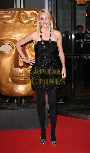 CAMILLA DALLERUP.The EA British Academy Children's Awards, Hilton Park Lane, London, England..November 29th, 2009.BAFTA BAFTAs full length black strapless dress hand on hip tights peep toe gold shoes necklace silver glittery sparkly.CAP/ROS.©Steve Ross/Capital Pictures.