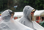 "Audience members sit in the rain to hear the ""Most Wanted Song Swap"" performance on the Main Stage at the 24th Annual Falcon Ridge Folk Festival, Hillsdale NY on Saturday July 28, 2012. Photograph taken by Jim Peppler. Copyright Jim Peppler/2012"