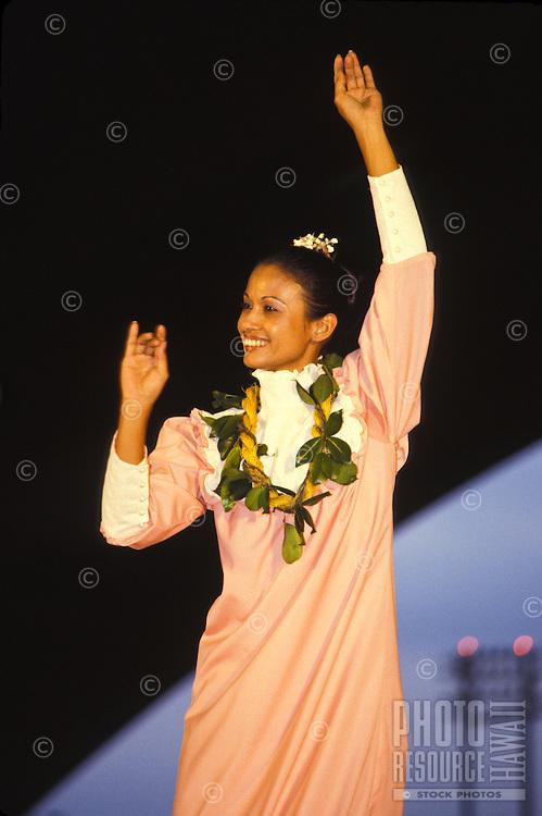 Woman dancing auwana hula at the Merrie Monarch Festival, Big Island