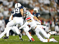 Ohio State Buckeyes linebacker Raekwon McMillan (5) tackles Penn State Nittany Lions safety Jesse Della Valle (39) on a special teams play at Beaver Stadium on October 25, 2014.  (Chris Russell/Dispatch Photo)