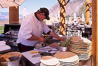 Nk'Mip Cellars Winery (Aboriginal Winery - owned by Osoyoos Indian Band), Osoyoos, South Okanagan Valley, BC, British Columbia, Canada - Chef preparing Restaurant Meal