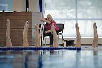 Russia Synchronized Swimming Olympic Team 2012..Head coach Tatiana Prokovskaya (R) give rhythm hitting a metallic pipe...The team is composed by: ISCHENKO Natalia;DAVYDOVA Anastasia;KHASYANOVA Elvira;GROMOVA Maria;ROMASHINA Svetlana;KOROBOVA Daria;PATSKEVICH Alexandra;SHISHKINA Alla;TIMANINA Angelica;KOLESNICHENKO Svetlana;ZUEVA Alexandra;OLHOVA Anisya..Only nine of these twelve can compete at the Olympics, due to number restriction imposed by I.O.C...Russian Team palmares: ..Olympic Games: (synchro at the Olympics since 1984)..Gold: 2000, 2004, 2008 ..World Championships..Gold 1999,2001,2003,2005,2007,2009,2011..European Championships: ..Gold; 1991,1993,1995,1997,1997,1999,2000,2002,2004,2006,2010..World Cup: Gold 2002, 2006,..Photo G.Scala/Deepbluemedia.eu..