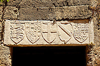 Heraldic Symbols on a lodge in the Avenue of the Knights. right are the 3 lions of the Great Seal of King John 1 of England used from 1198â1340, middle the cross of St George and  far right The arms of the Kings of England from 1340 to c.1411.  Rhodes, Greece, UNESCO World Heritage Site