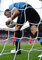July 26, 2012..Uruguay's Sebastian Coates (4) celebrates a goal by Uruguay. UAE vs Uruguay Football match during 2012 Olympic Games at Old Trafford in Manchester, England. Uruguay defeat United Arab Emirates 2-1...