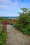 Vashon-Maury Island, WA<br /> Driscoll garden, flagstone pathway to a patio with a view of Quartermaster Harbor