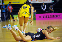 Jamie-Lee price goes down after colliding with Joline Henry during the ANZ Netball Championship match between the Central Pulse and Waikato Bay Of Plenty Magic at TSB Bank Arena, Wellington, New Zealand on Monday, 30 March 2015. Photo: Dave Lintott / lintottphoto.co.nz