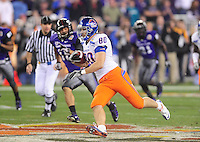 Jan. 4, 2010; Glendale, AZ, USA; Boise State Broncos tight end (80) Kyle Efaw runs with the ball after catching a psss on a fake punt play in the fourth quarter against the TCU Horned Frogs in the 2010 Fiesta Bowl at University of Phoenix Stadium. Boise State defeated TCU 17-10. Mandatory Credit: Mark J. Rebilas-