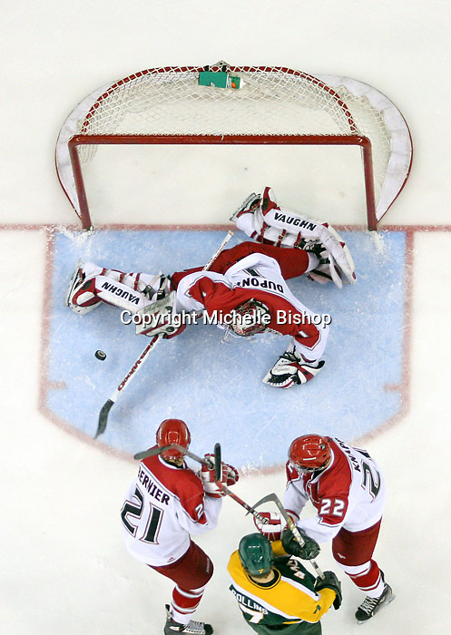 Nebraska-Omaha goalie Jeremie Dupont stops the puck as Mark Bernier and Dan Knapp battle with Northern Michigan's Dusty Collins. Nebraska-Omaha beat Northern Michigan 6-1 at the Qwest Center in Omaha on Jan. 27, 2007. (Photo by Michelle Bishop)