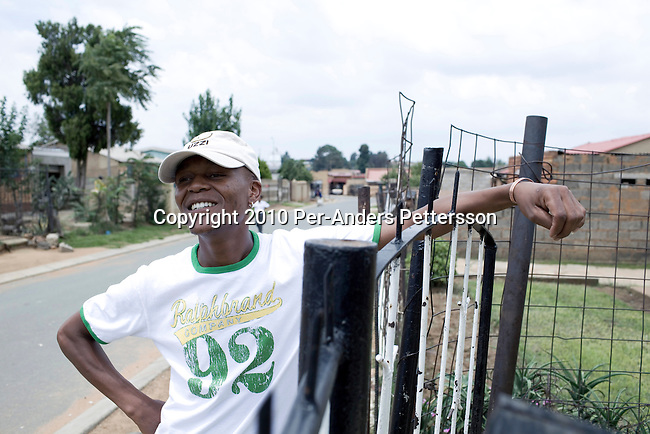SOWETO,SOUTH AFRICA - JANUARY15: Thami Nkosi, a 29-year old activist, stands outside his houseonJanuary15, 2010,in Soweto, South Africa. Thami is a gender justice activist and often counsels men how to use condoms and not to cheat or abuse women. He is part of the new young generation of black South African's who has got better education opportunities.Soweto is the largest township in South Africa, located about 10 kilometers southwest of downtown Johannesburg. The population is estimated to be around 2-3 million.(Photo by Per-Anders Pettersson/Getty Images)