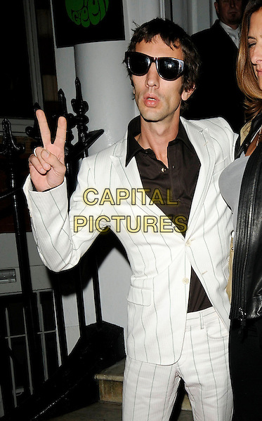 RICHARD ASHCROFT .At the Pretty Green Launch Party, The Gore Hotel, Queen's Gate, London, England, UK,.November 7th 2009..half length white pinstripe suit sunglasses v peace sign gesture .CAP/CAN.©Can Nguyen/Capital Pictures.