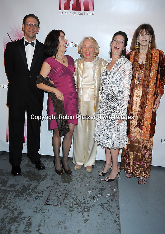 "authors David Finkel,Mary Karr, Liz Smith, Sara Gruen and Norris Church Mailer posing for photographers at the 26th Annual Literacy Partners Gala with Star-Studded ""Evening of Readings""  on May 10. 2010 at The Koch Theatre at Lincoln Center in New York City."