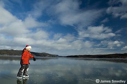 Children skating on a frozen lake in winter