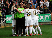 Pictured: Stephen Dobbie is mobbed by team mates after putting the home side two nil ahead<br />
