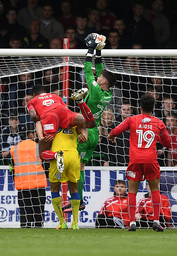 April 14th 2017, County Ground, Swindon, Wiltshire; Skybet league 1 football, Swindon Town versus AFC Wimbledon; Joe McDonnell, goalkeeper for AFC Wimbledon takes a cross under pressure from Jon Obika, forward for Swindon Town