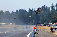 Aug. 3, 2014; Kent, WA, USA; NHRA funny car driver Jack Beckman blows the body off his car after an explosion during the Northwest Nationals at Pacific Raceways. Mandatory Credit: Mark J. Rebilas-