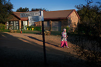 KLEINFONTEIN, SOUTH AFRICA - JULY 15: En elderly resident of the all white Kleinfontein community stands outside her house on July 15, 2013 in Kleinfontein outside Pretoria, South Africa. The all white town with about one thousand residents are all Afrikaners with a Vortrekker heritage. Only white Afrikaners who share Afrikaner culture, language and religion are allowed to settle in the town. (Photo by: Per-Anders Pettersson)