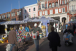 Market stalls and shoppers, Ipswich, Suffolk, England