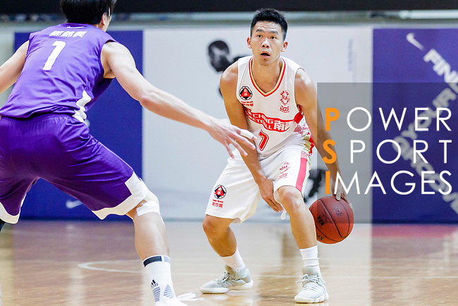 Wu Siu Chi #7of Nam Ching Basketball Team handles the ball against the HKPA during the Hong Kong Basketball League game between Nam Ching and  HKPA at Southorn Stadium on June 12, 2018 in Hong Kong. Photo by Yu Chun Christopher Wong / Power Sport Images