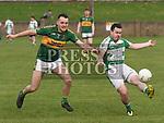 O'Raghallaigh's Ben Rogan Cooley Kickhams Luke White. Photo:Colin Bell/pressphotos.ie