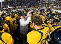 California head coach Jeff Tedford huddle with his team before going back to the tunnel before the game against UCLA at Memorial Stadium in Berkeley, California on October 6th, 2012.  California defeated UCLA, 43-17.