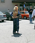 ....May 15th 2012 ..January Jones carrying a bag of bread food leaving Trader Joes market  wearing a Blue dress heart necklace brown gray purse bag leaving nail salon in Los Feliz just outside of Los Angeles. ..AbilityFilms@yahoo.com.805-427-3519.www.AbilityFilms.com..