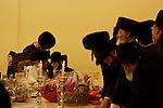 Israel, Bnei Brak. Purim feast at the Premishlan congregation, the Rabbi blesses his son, 2005<br />