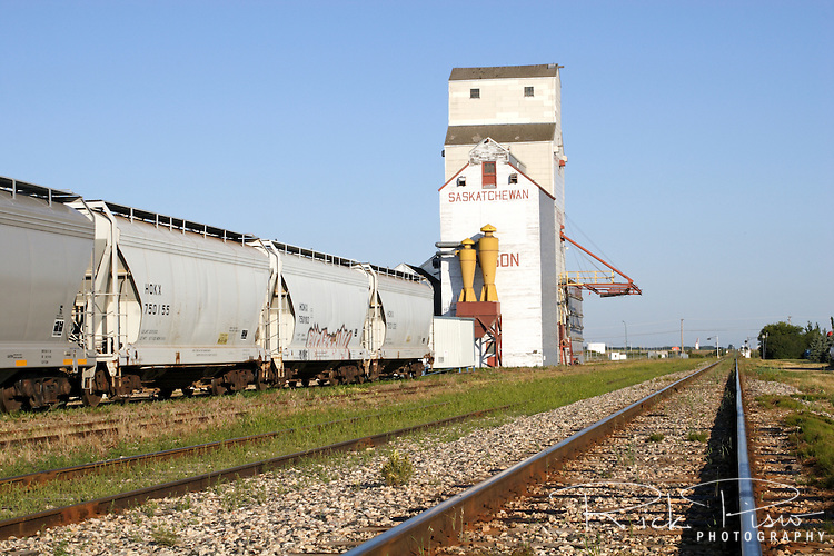 Grain elevator and railroad tracks in Watson, Saskatchewan.