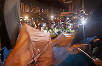Hong Kong police face off against pro-democracy protesters, shortly before the police lost control of the area, and thus ceding it back to the protesters, who had only just lost it to the police hours earlier in a pre-dawn raid, Mong Kok, Kowloon, Hong Kong, China, 18 October 2014.