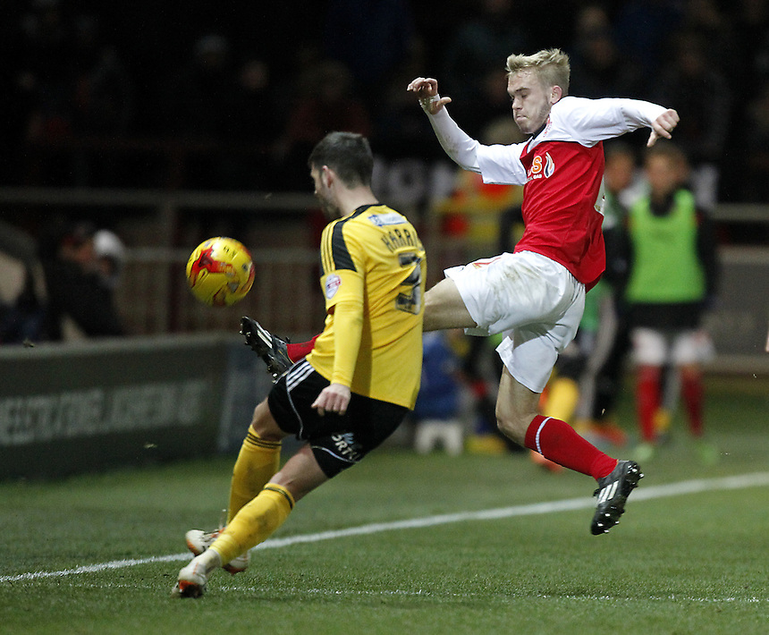 Fleetwood Town's Matt Hughes blocks a clearance from Sheffield United's Robert Harris<br /> <br /> Photographer Mick Walker/CameraSport<br /> <br /> Football - The Football League Sky Bet League One - Fleetwood Town v Sheffield United - Saturday 13th December 2014 - Highbury Stadium - Fleetwood<br /> <br /> &copy; CameraSport - 43 Linden Ave. Countesthorpe. Leicester. England. LE8 5PG - Tel: +44 (0) 116 277 4147 - admin@camerasport.com - www.camerasport.com