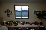 A view from the refreshment kiosk towards the pitch before Gala Fairydean Rovers host Gretna 2008 in a Scottish Lowland League match at Netherdale, Galashiels. The home club were established in 2013 through a merger of Gala Fairydean, one of Scotland's most successful non-League clubs, and local amateur club Gala Rovers. The visitors were a 'phoenix' club set up in the wake of the collapse of the original club, which had competed for a short time in the 2000s before going bankrupt. The home aside won this encounter 4-1 watched by a crowd of 120 at a stadium which features one of the country's most notable stands, a listed building constructed in 1964 but at the time of this fixture closed to spectators on safety grounds.