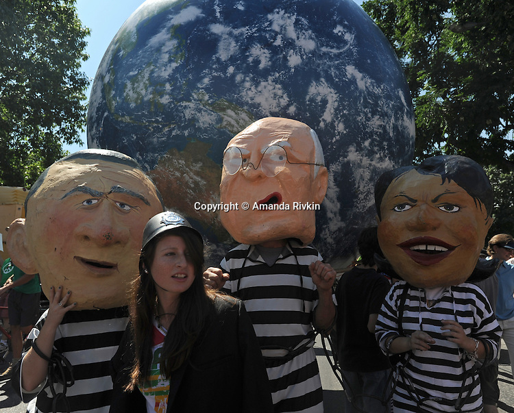Demonstrators pose as President George W. Bush, Vice-President Dick Cheney and Condoleezza Rice during an anti-war demonstration in Civic Center Park in downtown Denver, Colorado ahead of the Democratic National Convention on August 24, 2008.  The Democratic National Convention officially gets underway Monday August 25, 2008.