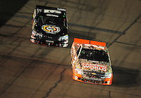 Nov. 7, 2008; Avondale, AZ, USA; Nascar Craftsman Truck Series driver Kevin Harvick (2) leads Kyle Busch (51) during the Lucas Oil 150 at Phoenix International Raceway. Mandatory Credit: Mark J. Rebilas-