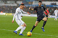 (L-R) Connor Roberts of Swansea City takes a cross past Morgan Fox of Sheffield Wednesday during the Sky Bet Championship match between Swansea City and Sheffield Wednesday at the Liberty Stadium , Swansea, Wales, UK. Saturday 15 December 2018