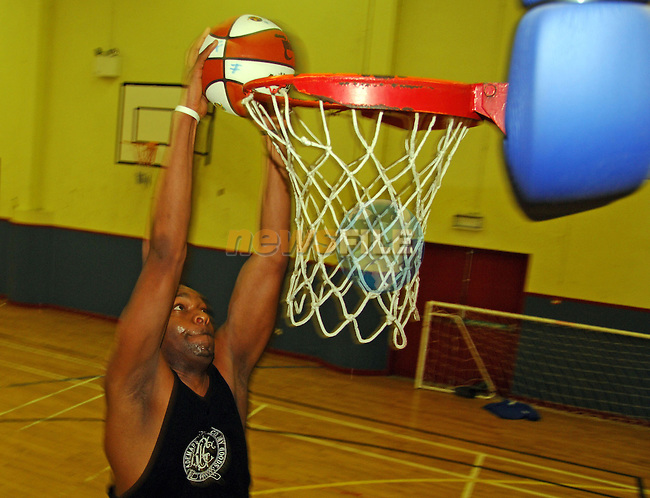 20-01-06 - Basketball feature for Examiner - Longford Falcons team members photographed at the Mall Complex, Longford..Longford Falcon 'Dre' performs a slam dunk at the above..Photo NEWSFILE/Barry Cronin..(Photo credit should read Barry Cronin/NEWSFILE)...This Picture has been sent you under the condtions enclosed by:.Newsfile Ltd..the Studio,.Millmount Abbey,.Drogheda,.Co Meath..Ireland..Tel: +353(0)41-9871240.Fax: +353(0)41-9871260.GSM: +353(0)86-2500958.email: pictures@newsfile.ie.www.newsfile.ie.FTP: 193.120.102.198..This picture is from Fran Caffrey@newsfile.ie